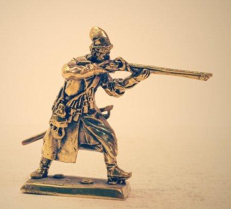 6.Стрелец стреляющий из мушкета.